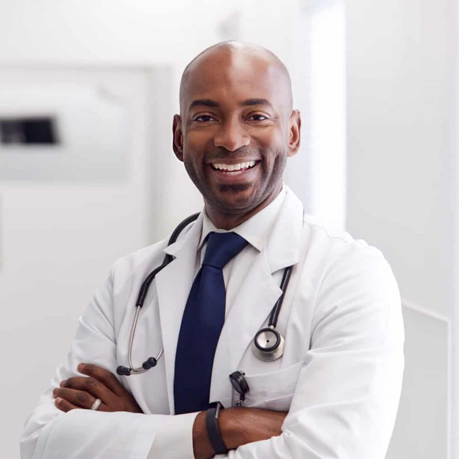portrait-of-mature-male-doctor-wearing-white-coat-H49URGD-1.jpg