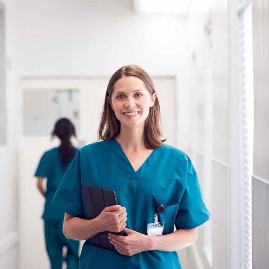 portrait-of-smiling-female-doctor-wearing-scrubs-HZ79GZQ-1.jpg